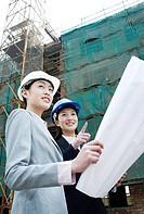 Businesswomen having discussion at construction site