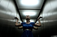 Young woman posing in elevator
