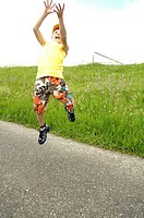 Boy jumping in mid_air