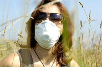 Close_up of mid adult woman wearing mask in field