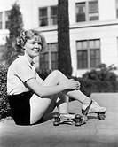 Woman in roller skates sitting on a sidewalk All persons depicted are not longer living and no estate exists Supplier warranties that there will be no...