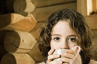 Girl drinking from mug