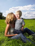 Mother and son playing in a field