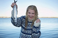 Young Woman having caught fish