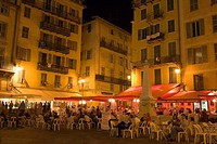 Group of people sitting at a sidewalk cafe, Nice, France