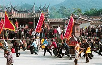 Men carrying palanquin in fair, Mountain temple fair performance of Beichen---Meeting the god, Beichen Mountain, Tongan County, Fujian Province of Peo...