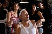 Young men and women in hip_hop fashion partying and dancing