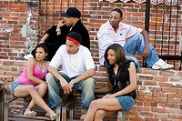 Group of young people hanging out in a back alley