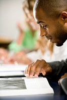 Close_up of a student reading