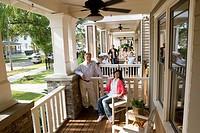 Next_door neighbors on front porches