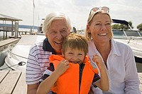 Grandparents and grandson at the lake