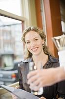 Woman holding restaurant menu