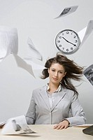 Wind blowing on businesswoman at desk