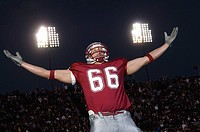 Football player with arms outstretched