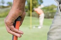A man holding a golf club
