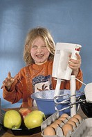 Child cooking with mixer