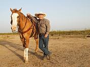 Mixed Race man next to horse