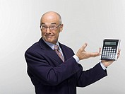 Businessman holding calculator, portrait