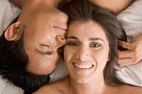 Hispanic couple with heads touching