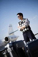 Man with Baggage by Airplane