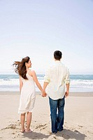 Asian couple holding hands at beach