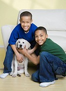 African American brothers petting dog