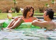 Hispanic couple in swimming pool