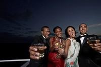 Multi-ethnic couples toasting