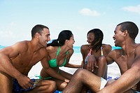 Multi-ethnic couples in bathing suits