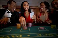 Multi-ethnic couples gambling
