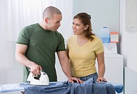 African American couple ironing