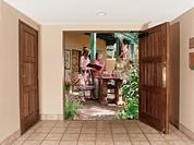 View through doorway to multi-ethnic women on patio