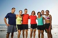 Multi-ethnic runners at beach