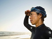 Asian woman wearing wetsuit and goggles