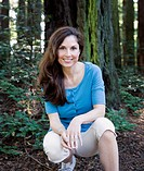 Portrait of Hispanic woman in woods
