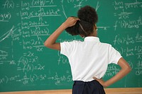 African American girl looking at blackboard
