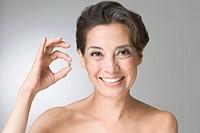Hispanic woman holding vitamin