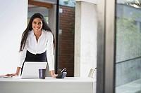 Confident businesswoman with a laptop computer
