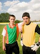 Hispanic male soccer players on field