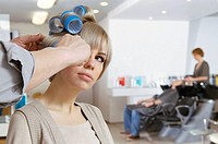 Hairstylist using rollers
