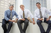 Three businessmen outdoors on a lunch break