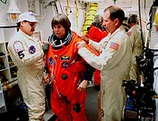 02/11/2000 ___ Before entering the orbiter Endeavour, STS_99 Mission Specialist Janice Voss is helped by Travis Thompson and Jack Burritt, members of ...