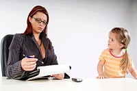 business woman with child in office