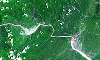 The above image shows a 60_kilometer stretch of the Yangtze River in China. In the image, one can see the Xiling Gorge, which is the easternmost of th...