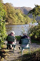 UK, England, Cumbria, The Lake District, Grasmere, Keswick Road, Waterside Hotel, The Lake at Grasmere, chairs, senior couple,