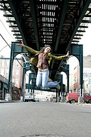 View of a young woman jumping