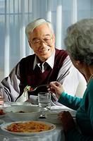 Elderly couple at dinner table