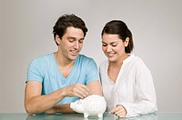 Couple with piggy bank