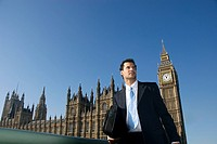 A businessman in front of the house of parliament
