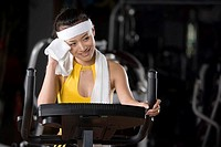 a woman using fitness equipment